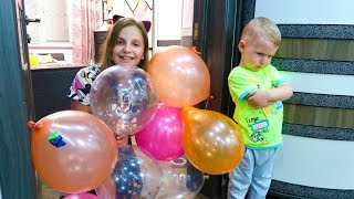 Andrei and Irochka playing with balloons