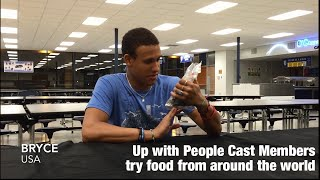 UWP Cast Members try food from around the world