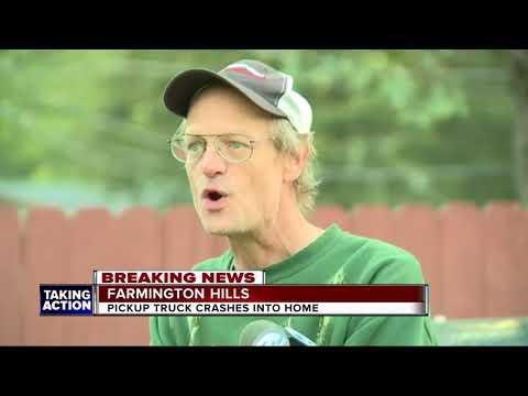 Truck crashes into home in Farmington Hills