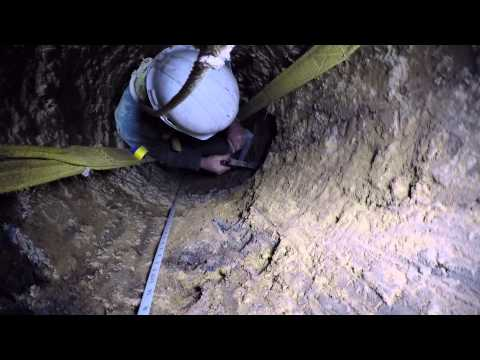 Geologists inside testhole
