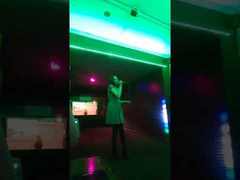 Kelsey singing at Karaoke Lonigans