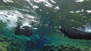 Snorkeling between American and European tectonic plates - Silfra, Iceland