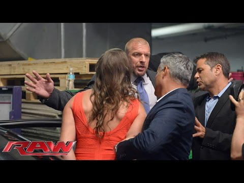 Stephanie McMahon is escorted out of the arena: Raw, July 21, 2014