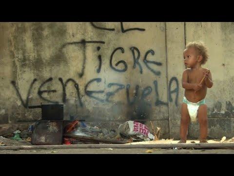 Desperate Venezuelans put dreams on hold in Brazil border camp