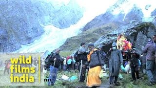 Pilgrims carrying palanquin of Goddess Nanda Devi during Raj Jat Yatra