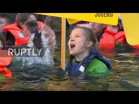 Germany: Greenpeace Youth dive into Spree river to protest coal mining