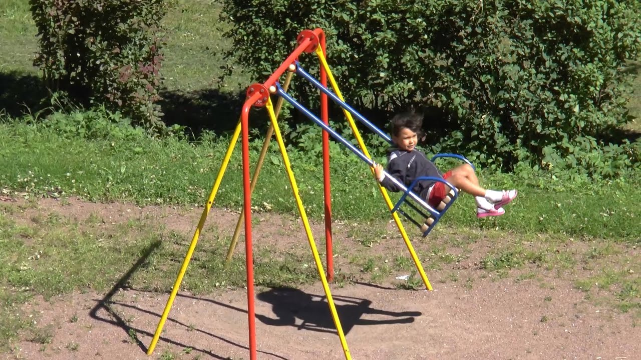 Kids On Swing At Outdoor Park Hanging Seat Music Video