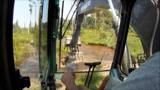 Excavator Busting Beaver Dams