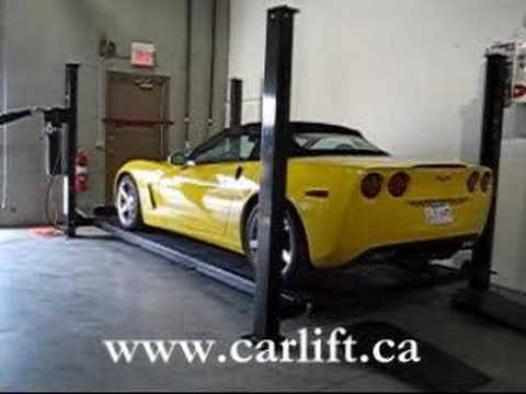 Residential Car lift with a Corvette and BMW M5