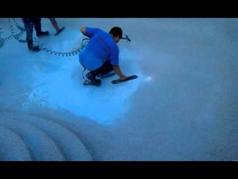 how to clean pebble tec pool surface