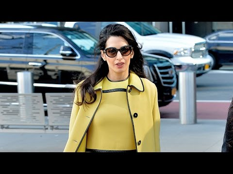 Pregnant Amal Clooney Stuns in Yellow While Working in NYC!