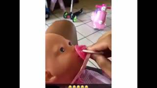 Kid reacts to baby doll