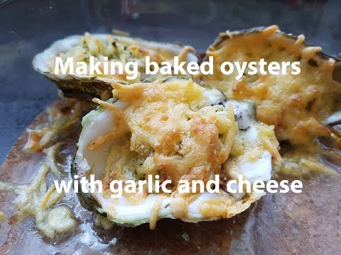 Making Baked Oysters With Garlic And Cheese