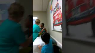 Little kid cries while having flu shot