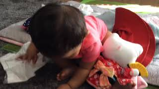 Baby finds interesting things on floor