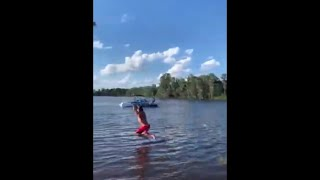 Guy Performs An Impressive Backflip Off A Tractor Rope Swing