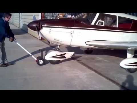 Repeat Minimax towing Piper Cherokee 235 by Gregory