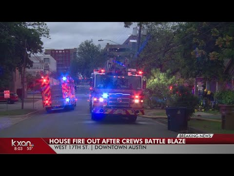 Crews battle two-story house fire in Downtown Austin