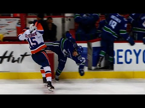 Boeser injured after massive hit from Clutterbuck