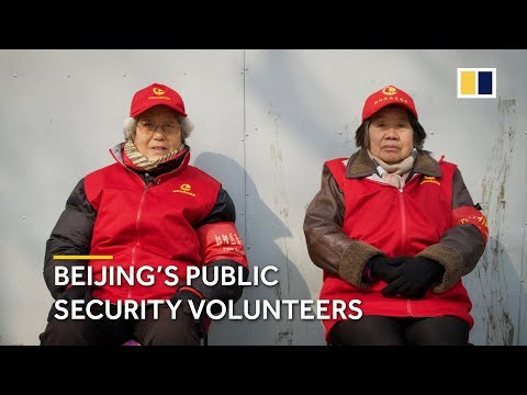 The public security volunteers Beijing relies on to keep order