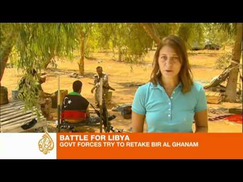 Libyan rebels battle for western town on road to coast