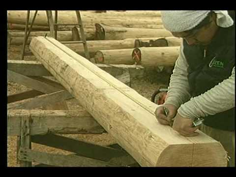 Principal rafters building a log cabin with logs for trusses and roof framing