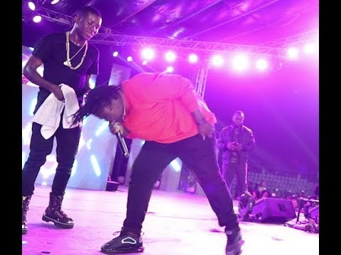 Barrister Son dazzles the Agege crowd as he bows for Small Doctor while singing together