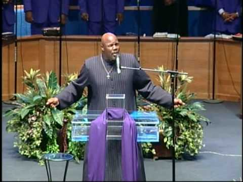 pastor sings by the grace of God