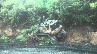 CAT dozer clearing brush