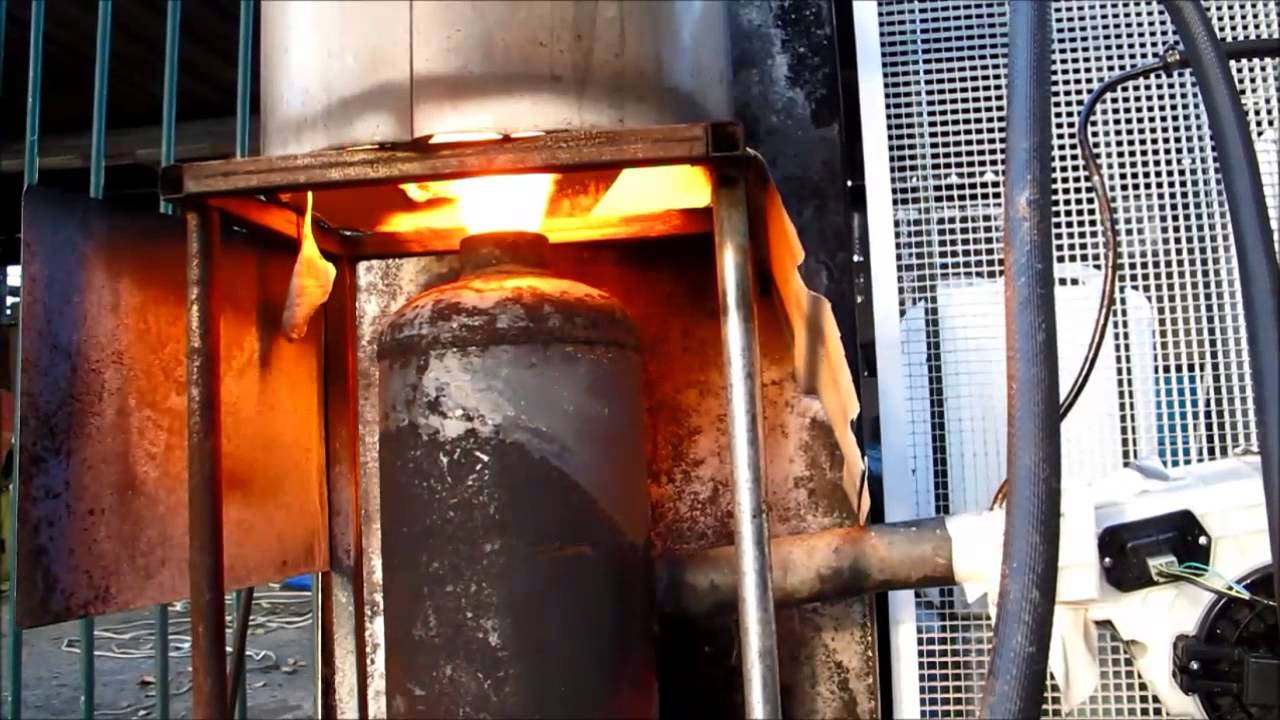 Using waste oil to heat domestic hot water system - YouTube
