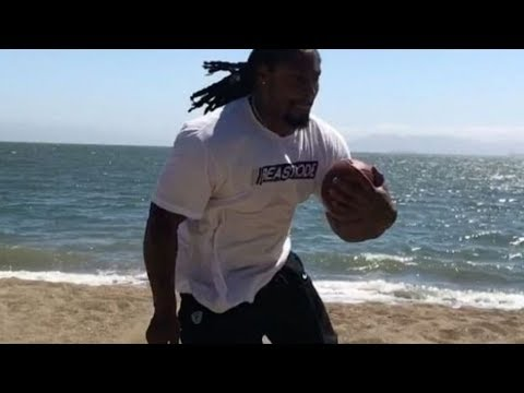 Marshawn Lynch BEASTS Beach Drills While Wearing Boots in the Sand!