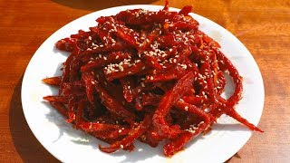 Dried shredded pollock seasoned with gochujang (Bugeopo gochujang-muchim: 북어포 고추장무침)