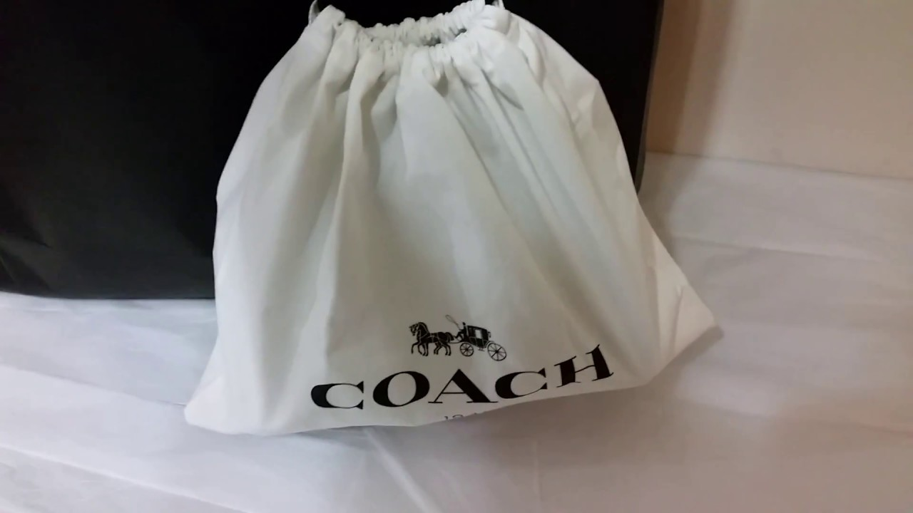 06f5ed5db1 COACH  Dinky in Glovetanned Leather With Flora Bow Print - YouTube