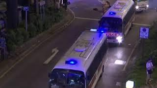 香港爆发反水货客抗议 防暴警察列队前进驱散抗议者