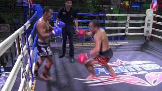 Kru Dendanai lands a cartwheel kick