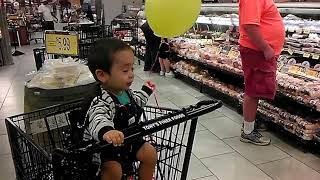 Amir's Adventures - Baby Amir at Mariano's with a Yellow Balloon
