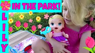 baby alive snacking lily is having fun in the park feeding her real baby puffs fake milk bottle