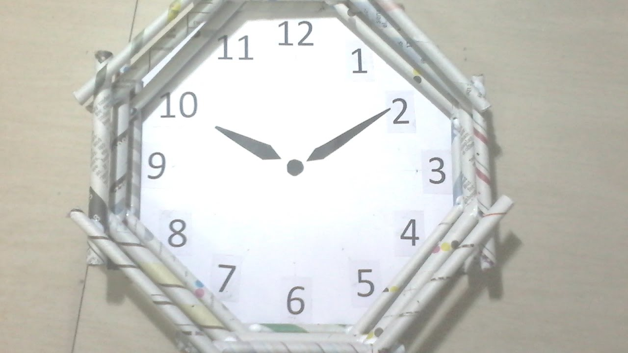 DIY: How to make Wall clock using news paper rolls