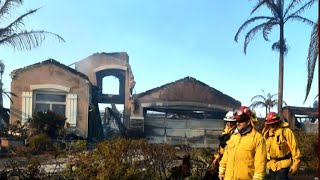 California crews search for victims as wildfires burn on