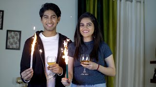 Happy boyfriend and girlfriend enjoying and celebrating Valentine's day at home