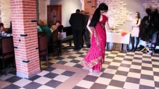 the beautiful Russian girl dances the Indian dance