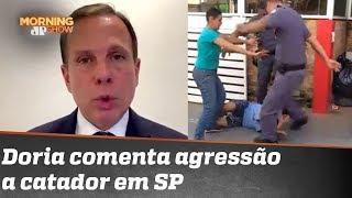Policiais são afastados por agressão a catador; Doria comenta
