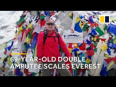 Elderly Chinese double amputee climbs Mt Everest
