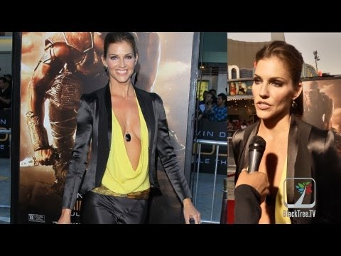 Tricia Helfer's outfit turns heads on RIDDICK red carpet