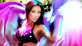 Beautiful Asian Woman dances a Belly Dance in Bikini.