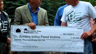Builders Association Presents $20,000 Check for Flood Victim