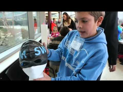 "Liam Roehr, a sixth grader at the Gagie School. shows his invention ""Dual Cap"" which combines goggle"