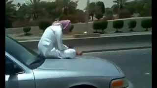 crazy Arab Dangerous driving on motorway sitting on car banat