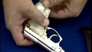 how to unload a tip up taurus 22 semi auto pistol