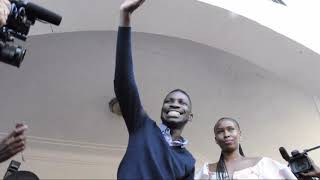 Bobi Wine waving at fans at his home in Magere